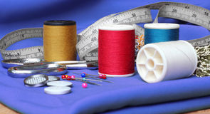 Sewing items. On fabric background stock image