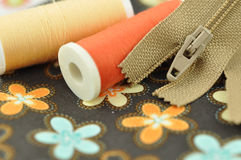 Sewing Items on Floral Cloth Royalty Free Stock Photos