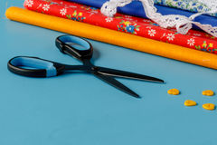 Sewing items, isolated on blue royalty free stock images