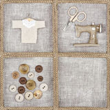Sewing items on rustic linen background Royalty Free Stock Photos
