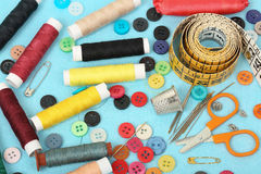 Sewing items. Set of sewing items on blue fabric royalty free stock photos