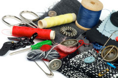Sewing Items. With Various Buttons, Pins, Spools, Threads, Scissors and Textile closeup on white background stock photo