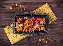 Sewing items in yellow and red arranged on a vintage tray Stock Photography