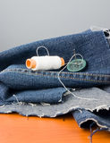 Sewing jeans Stock Photography