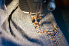 Sewing jeans. Stock Photo