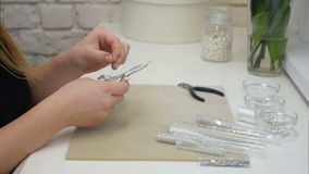 Sewing jewelry accessories with beads stock video