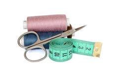 Sewing Kit. Thread, scissors and measuring tape isolated on white background Stock Images