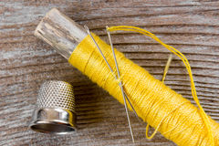 Sewing kit. Accessory of the tailor, on wood Royalty Free Stock Photo