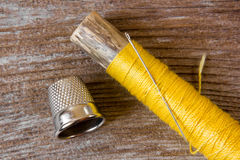 Sewing kit. Accessory of the tailor, on wood Stock Images
