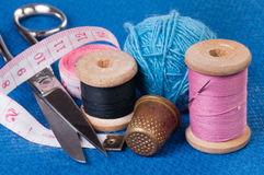Sewing Kit on blue fabric Royalty Free Stock Image