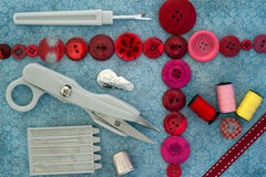 Sewing kit and buttons background Stock Images