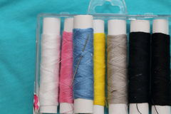 Sewing kit on the fabric Royalty Free Stock Image