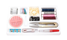 Sewing kit, needles,button, thread in a white box Royalty Free Stock Photography