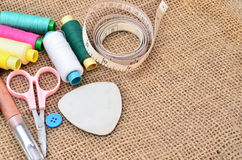 Sewing kit. Scissors, bobbins with thread and needles Stock Photography