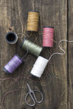 Sewing kit. Scissors and  bobbins with thread Stock Images