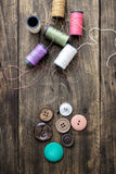 Sewing kit. Scissors and  bobbins with thread Royalty Free Stock Photos