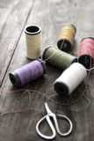 Sewing kit. Scissors and  bobbins with thread Royalty Free Stock Photo
