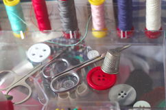 Sewing kit, spools of thread scissors, thimble tailor buttons needles and pins Royalty Free Stock Photos