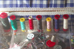 Sewing kit, spools of thread scissors, thimble tailor buttons needles and pins Stock Photo
