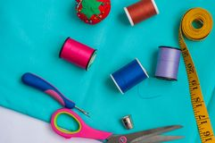 SEWING KIT TOP VIEW WITH THREAD royalty free stock photo