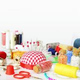 Sewing kit on white background royalty free stock photography