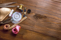 Sewing kit on the wooden background Stock Photos