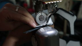 Sewing leather part in slow-motion stock video