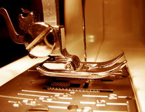 Sewing machine. Needle plate and foot of a sewing machine - close up Stock Photo
