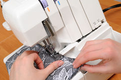 Sewing on the machine Stock Photos