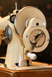 Sewing machine. A front side photo of an old classical manual sewing machine with a crank to make it work Stock Photo