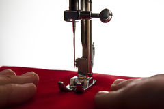 Sewing machine. A pair of hands using a sewing machine Royalty Free Stock Image