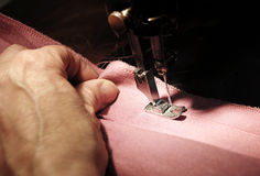 Sewing machine. To sew a material on the sewing machine royalty free stock photo