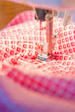 Sewing machine. Needle and thread on sewing machine royalty free stock images