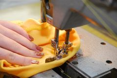 Sewing-machine. Woman's hand and sewing-machine Royalty Free Stock Photography