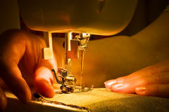 Sewing with a machine Royalty Free Stock Image
