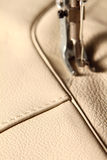 Sewing machine. In action for working leather for a sofa stock photos