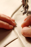 Sewing machine. In action for working leather for a sofa stock photo