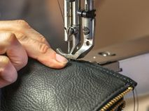 Sewing machine operated in workshop Royalty Free Stock Photography
