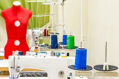 Sewing machine in the atelier room. Royalty Free Stock Photography