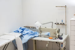 Sewing machine and the blue cloth Royalty Free Stock Photography
