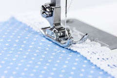 Sewing machine with blue cloth Stock Images