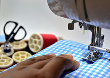 Sewing machine. Blue fabric and tool Stock Images
