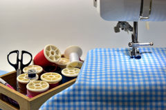 Sewing machine. Blue fabric and tool Royalty Free Stock Photo