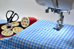 Sewing machine. Blue fabric and tool Royalty Free Stock Image