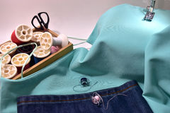 Sewing machine. Blue lady singlet,Jeans and equipment Royalty Free Stock Images