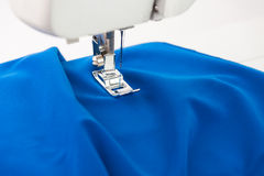 Sewing machine and bright fabric Stock Photography