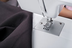 Sewing machine with a brown fabric. Closeup Stock Image