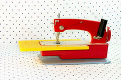 Sewing machine, children`s toy of red color Stock Photo
