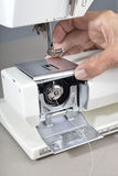 Sewing machine cleaning and maintenance. Royalty Free Stock Photography