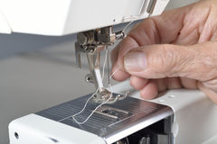 Sewing machine cleaning and maintenance. Stock Image